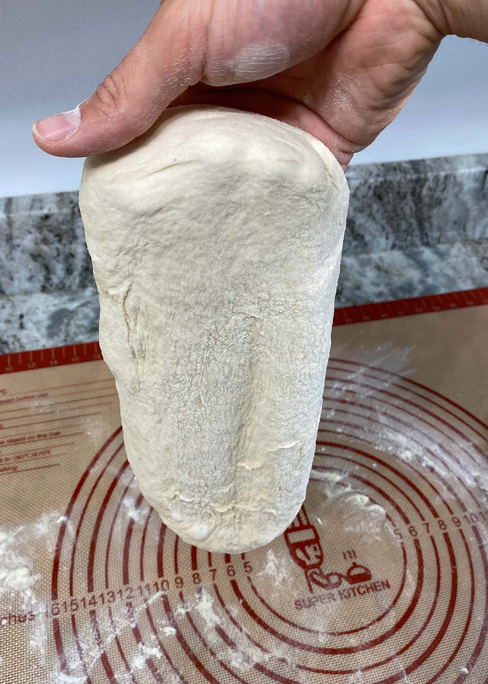 Letting pizza dough form